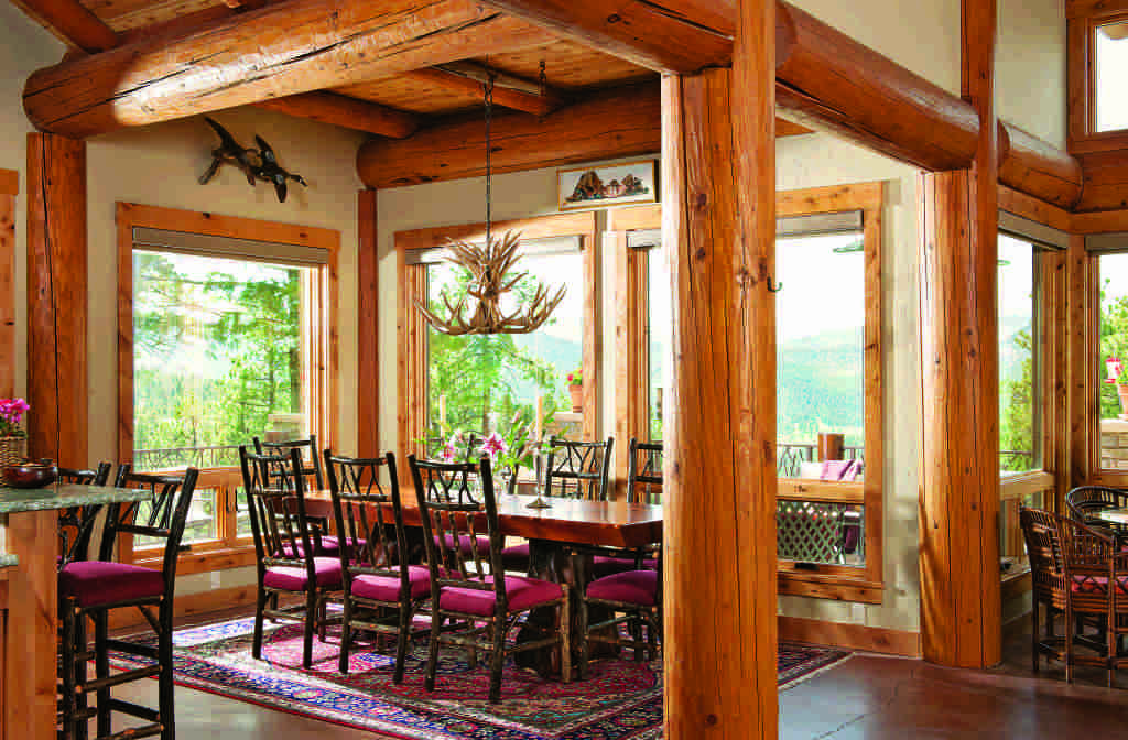 log home dining space with view