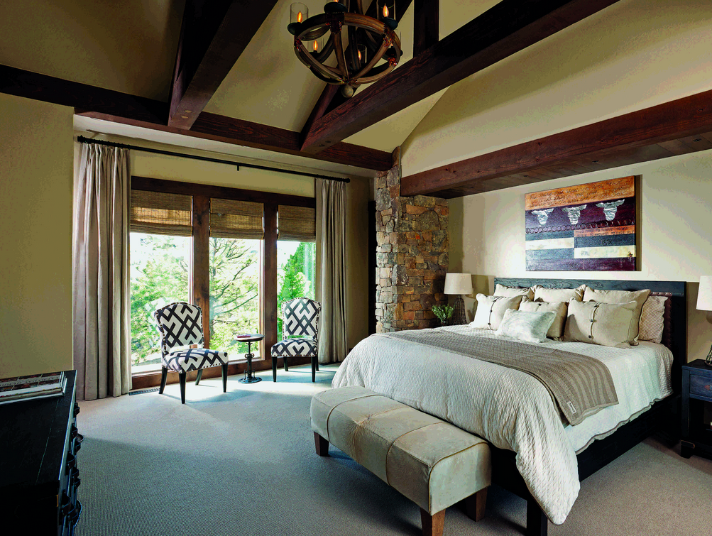 timber home bedroom wood beams cream bed