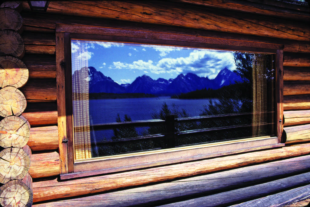 logs mountain reflection window pane