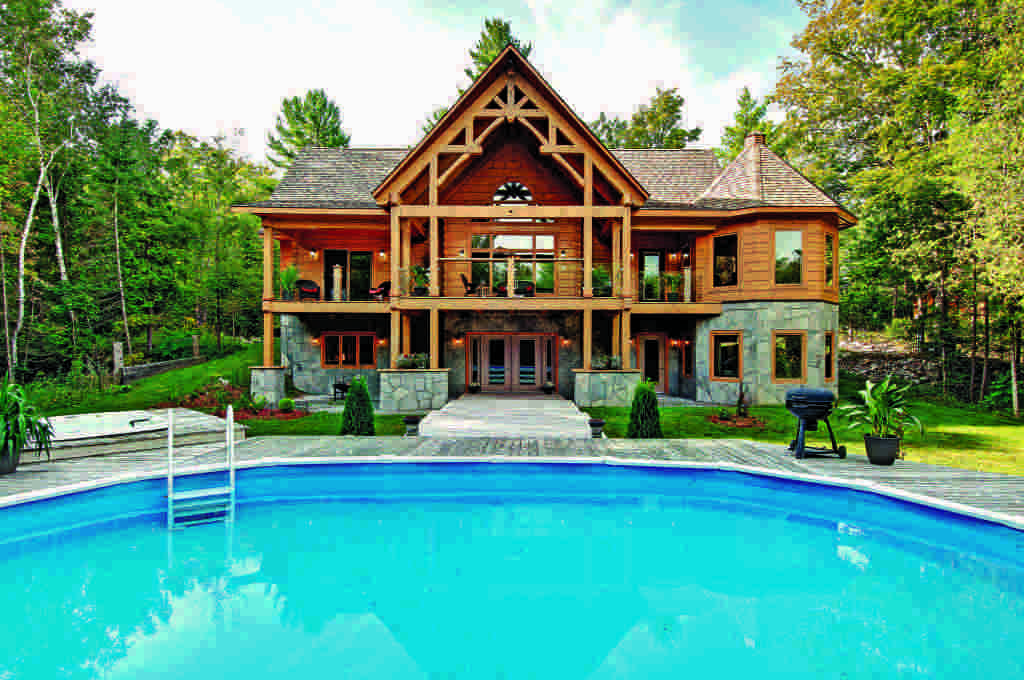 log and timber Exterior Poolside with timber covered deck