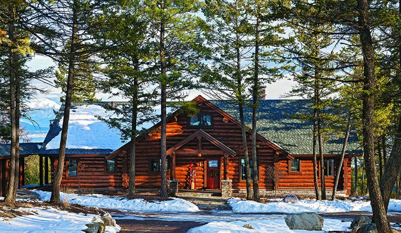 Montana log home snow winter trees