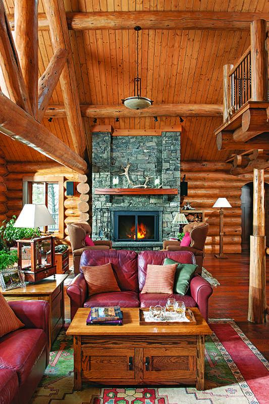 Montana log home interior great room stone fireplace
