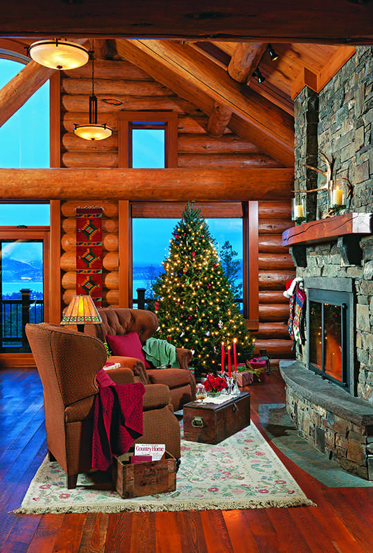 log home great room Christmas tree stone fireplace