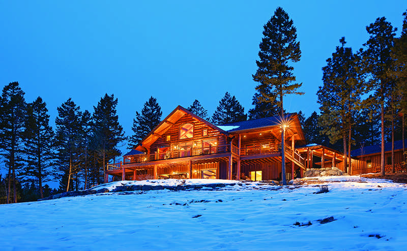 log home exterior back view snow forest nature