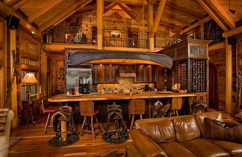 hybrid log home kitchen bar saddle stools canoe light fixture wine cellar