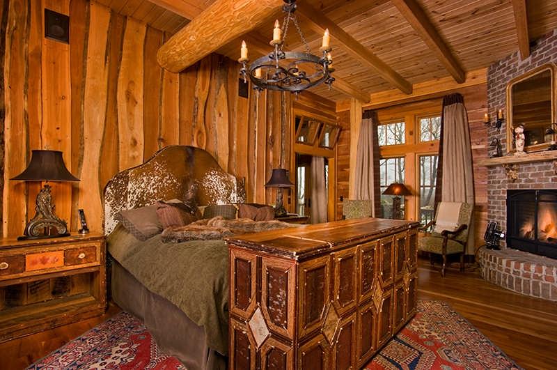 hybrid log home bedroom brick fireplace