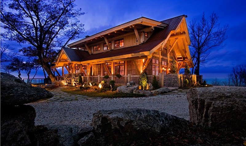 hybrid log home exterior evening night sky lighting