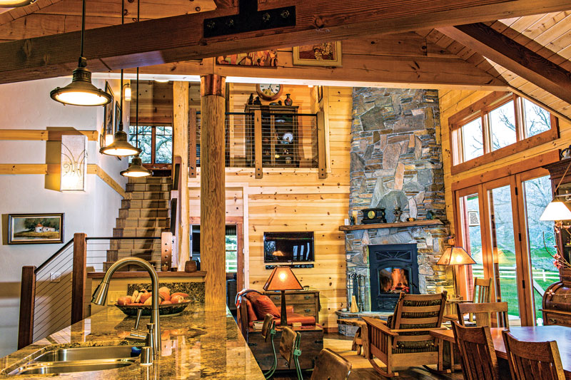 white pine log ranch great room stone fireplace