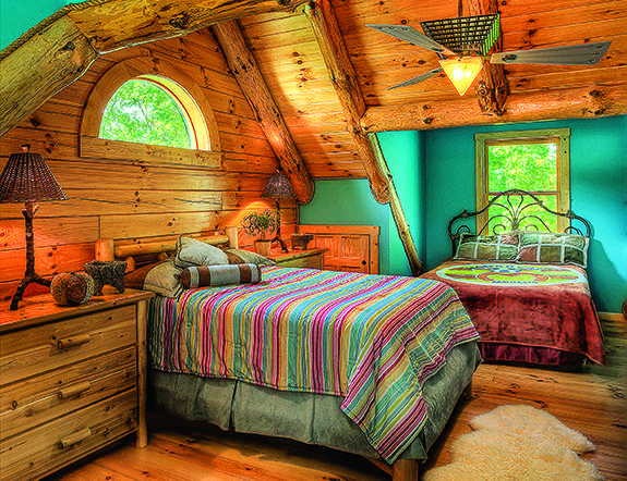 Adding color to a log home bedroom