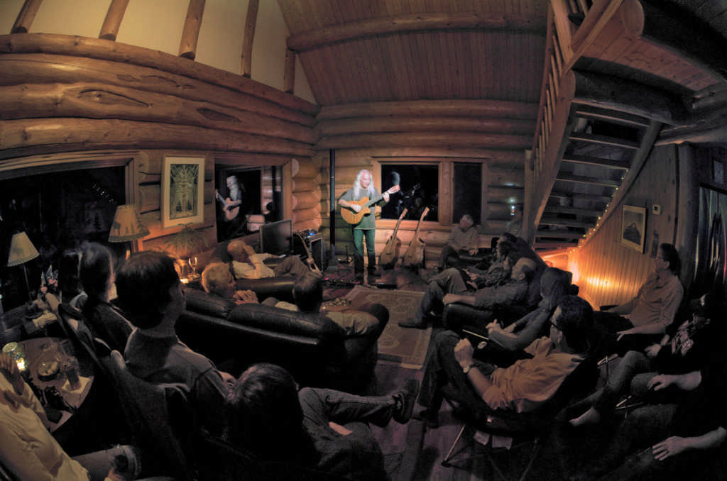 musicians in log home