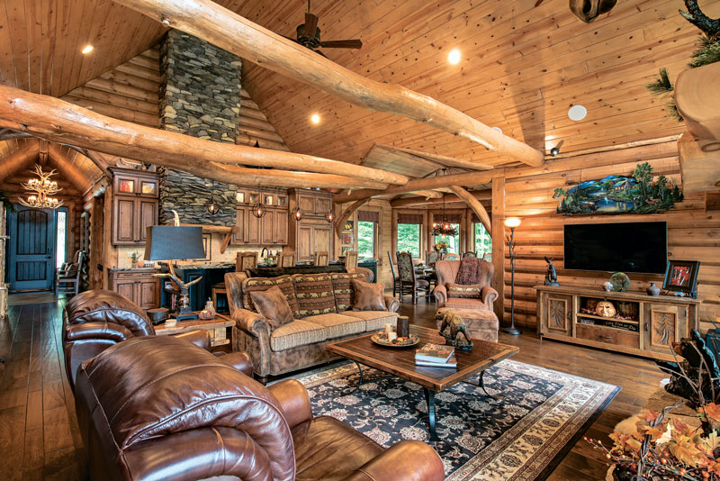 Living-Room-Great-Unique-Tie-Beams-Wood-Flooring-Interior-Dowell-(Golden-Eagle-Log-Homes)-11