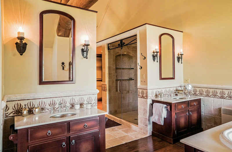 A Miami Couple Finds Shelter From Floridas Intense Summer Swelter In Lovingly Restored Canadian Log Home Including Glamorous Bathroom With Spanish