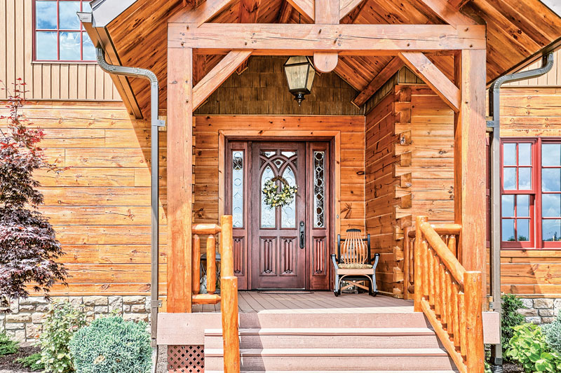 The dramatic front entry hints at the beauty  of the home inside. The porch decking is make from a composite product that is virtually maintenance-free.