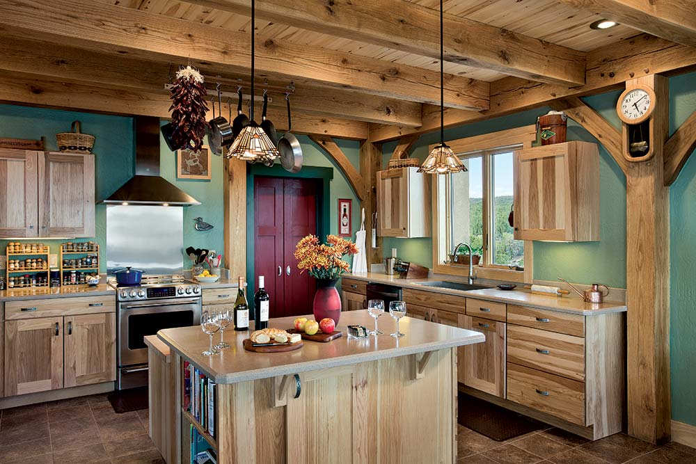 The color of the hickory kitchen cabinets, made by a local craftsman, complements the timbers.