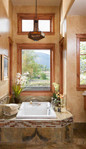 The master bathroom features radiant heat floors, a granite-tiled shower with a rainfall shower head and a sunken bathtub, but the best offering may be the views.
