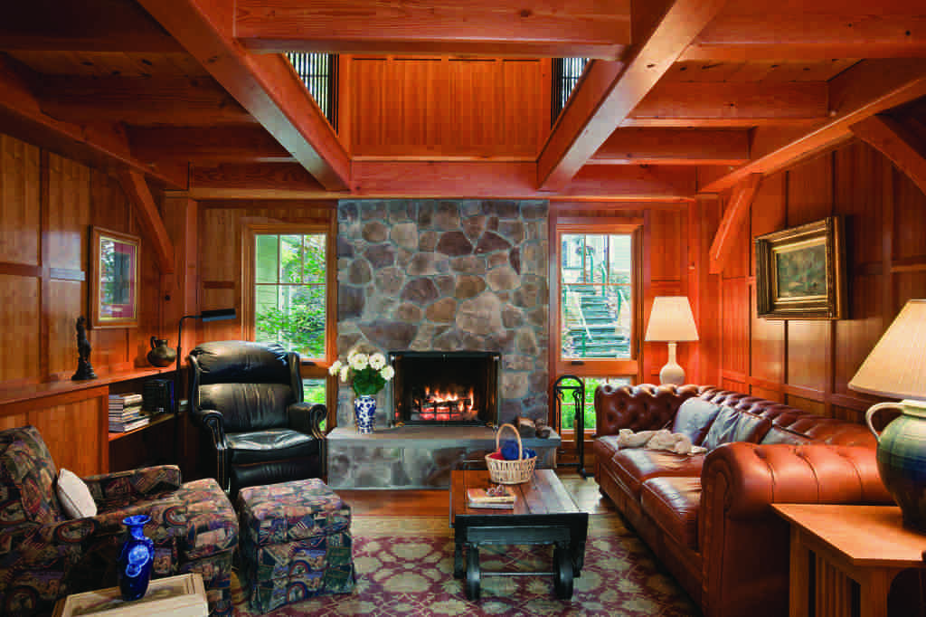 New York timber home wood paneling walls stone fireplace