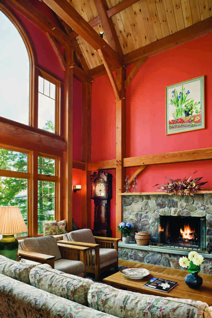 New York timber home red walls timber beams great room stone fireplace