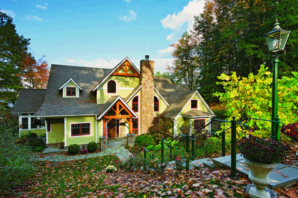 Add an element of surprise by going bright on your home's exterior. Photo by Roger Wade. Home by Woodhouse, The Timber Frame Company.
