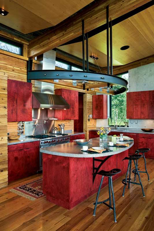 Red cabinetry in a rustic finish makes a statement in any wood home. Photo by Heidi Long.