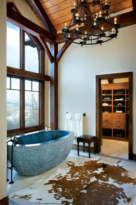 Sometimes a touch of color goes a long way, like this striking blue soaking tub. Photo by Roger Wade. Home by Woodhouse, The Timber Frame Company.