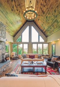 The dramatic roof pitch allows for soaring windows in the great room that seem to bring nature inside. The windows capture long views, uninterrupted by any other homes.
