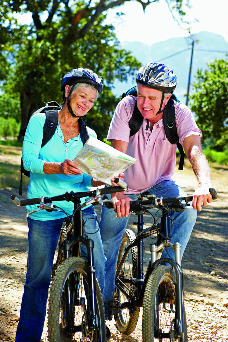 senior-couple-with-map-on-country-bike-ride