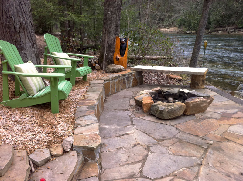 cabin firepit fireplace bonfire boulders rocks adirondack chair creekside
