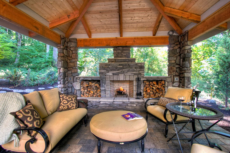 cabin firepit fireplace bonfire boulders firewood covered patio