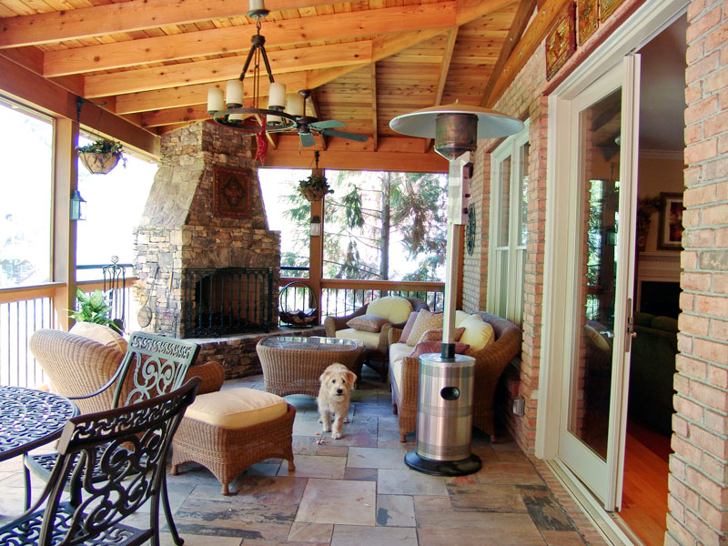 outdoor fireplace covered porch outdoor seating deck patio