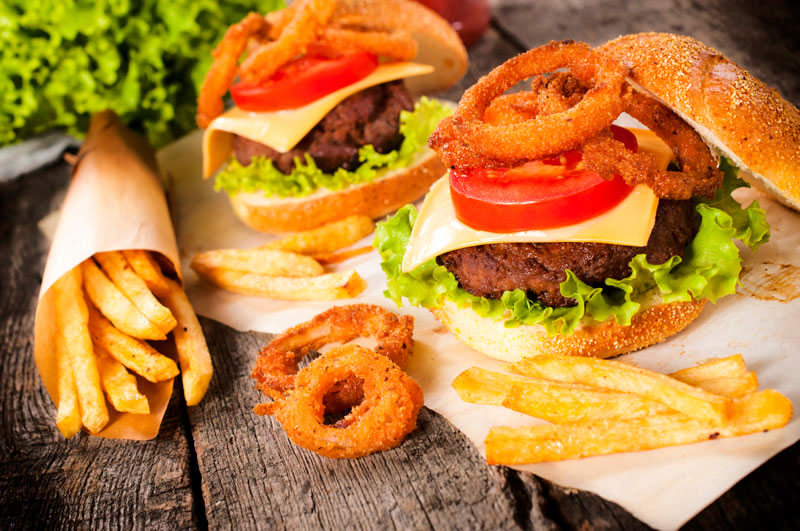 burgers fries onion rings fried food