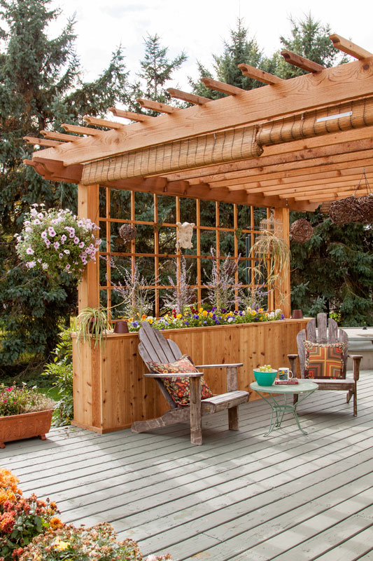 Perpendicular to the joists, I ran 2x2 cedar strips ripped from 2x4s to  create a nice counterpoint. I knew I wanted to grow wisteria over the  pergola roof, ... - Adding A Pergola To A Cabin Deck