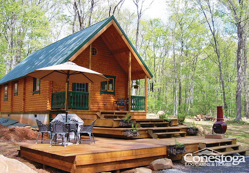 Charmant A Porch And Large Deck Expand The Living Space Of This 727 Square Foot Cabin.  Itu0027s The Vacationer Model By Conestoga Log Cabins U0026 Homes.
