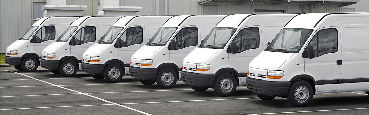 Fleet of white vans lined up at depot