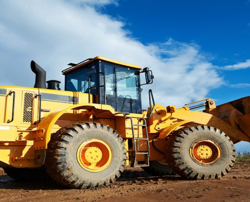 Serving the construction industry, heavy construction loader bulldozer at construction area