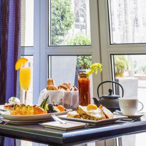 Mimosa cocktails, fruit platters, eggs, breadbasket