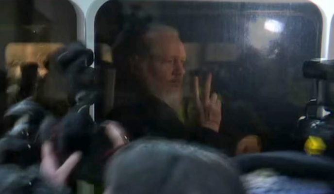 Julian Assange arrested in London, accused by US of conspiring in 2010 computer hacking attempt