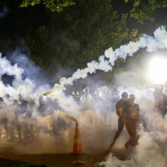 Demonstrators defy curfew and hold protests for sixth straight night in the US