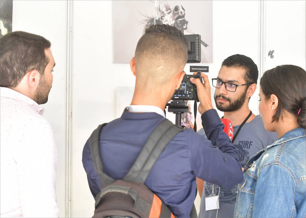 Hamza Bendriss being interviewed by Moroccan media