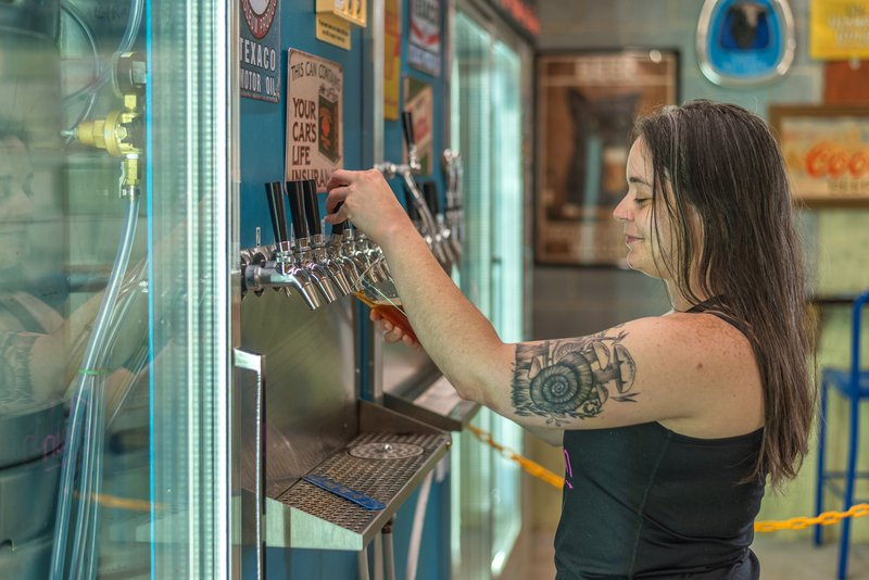 Bartender pouring a beer at Mica Town Brewery in Nebo, North Carolina