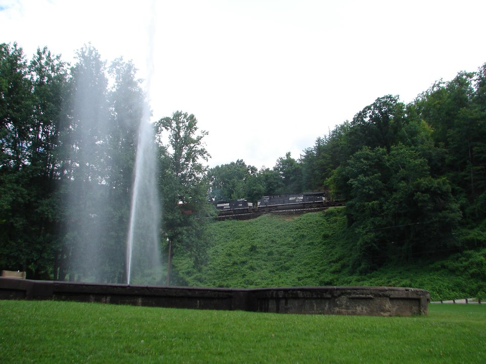 geyser with train passing