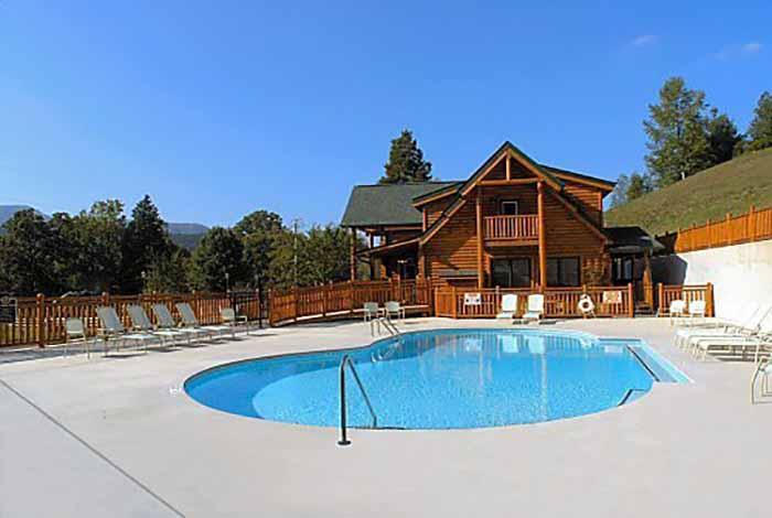 Pigeon forge cabin big black bear lodge 4 bedroom - Gatlinburg falls resort swimming pool ...