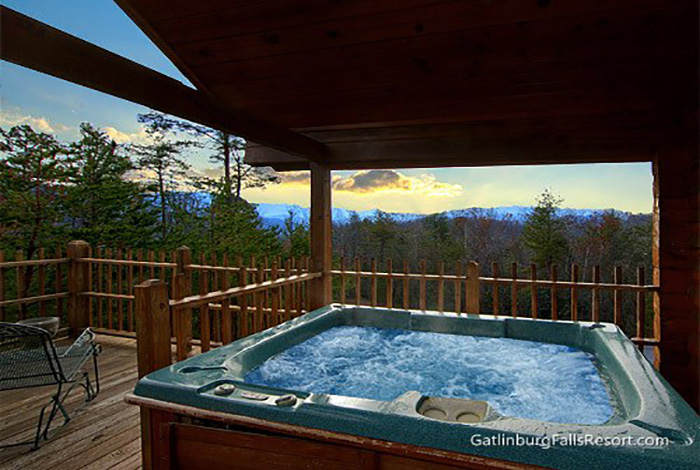 mountain shomos log tub s gatlinburg cabin cabins with hottub rentals in tn alan chalet bedroom hot tennessee