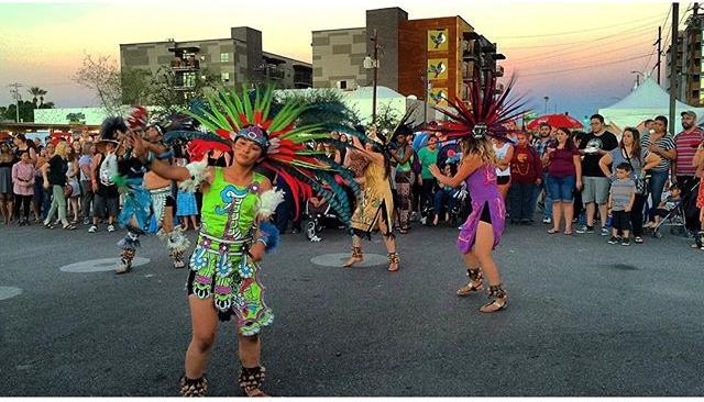 Photo by user downtownphoenix, caption reads We were blown away by the beautiful colors and movements of the traditional Aztec dancers! Music, fun, dancing, food and drinks continue at Chile Pepper Fest 'til 10 p.m.! #dtphx Check out out IG STORY for a sneak peek!