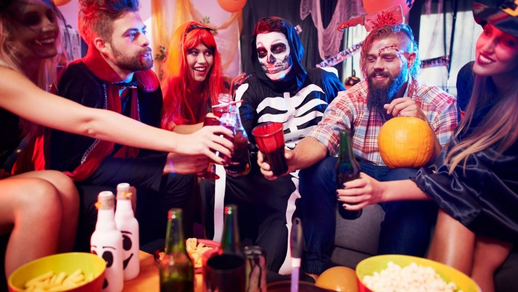 Halloween photo featuring people dressed up in costumes at a party