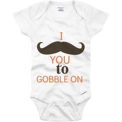 Mustache gobble onesie