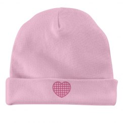 pink baby hat with heart design