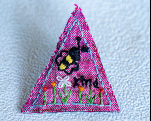 "Hand Embroidered ""Bee Kind"" Triangle Pin"