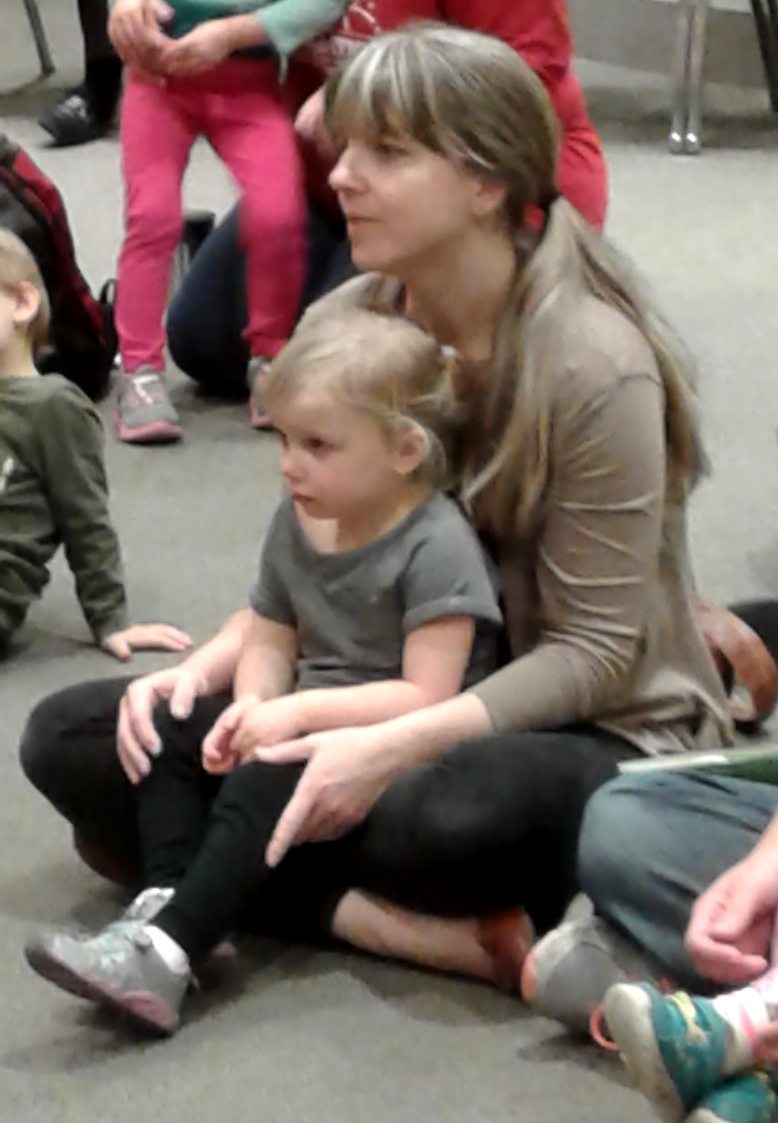 photo of child and grown-up at family storytime