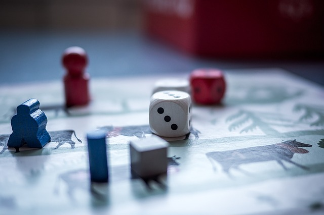 Dice and pawns on a game board