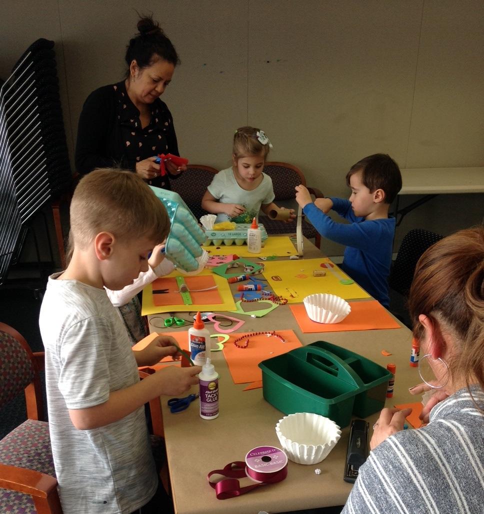 Children their grownups making crafts